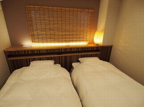 5名用以上の客室はベッドと布団両方あり。3世代利用にも好評