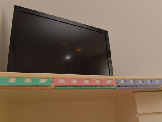 テレビ台にもクッションを設置しています。
